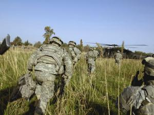 US Army Soldiers Prepare to Board a UH-60 Black Hawk Helicopter by Stocktrek Images