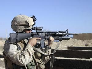 US Marine Sites Through the Scope Atop His 556mm M16A2 Rifle by Stocktrek Images