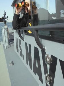 Us Navy Mate Looks Through Binoculars as He Patrols the Coastal Waters of the Persian Gulf by Stocktrek Images