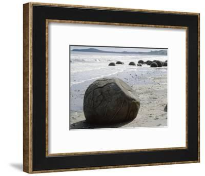 Stone boulders on the beach at Moeraki Point, South Island, New Zealand-Werner Forman-Framed Photographic Print
