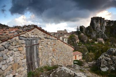 Stone Buildings Beneath Dark Clouds Near Verdon Gorge-Keith Ladzinski-Photographic Print