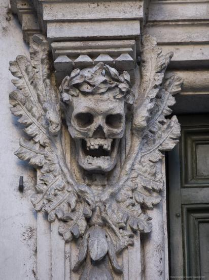 Stone Carving of a Laurel Leaf Encircled Human Skull on a Pilaster  Photographic Print by Stephen Alvarez | Art com