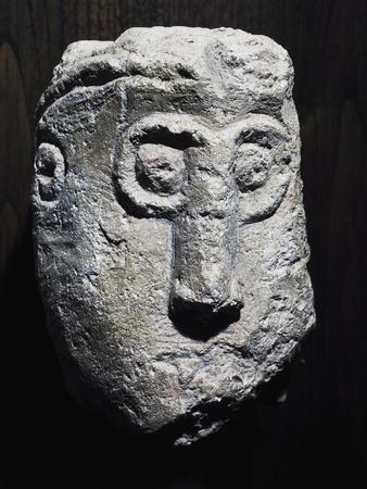 https://imgc.artprintimages.com/img/print/stone-head-with-gorgon-shape-picenum-culture_u-l-povnre0.jpg?p=0