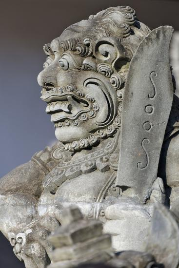 Stone Statue at Entrance of Tanah Lot. Bali Island, Indonesia-Keren Su-Photographic Print