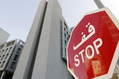 Stop Sign in Front of Modern Architecture in the Financial District, Dubai, United Arab Emirates-Axel Schmies-Photographic Print