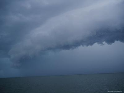 Storm Cloud Hanging Low over the Water-Raul Touzon-Photographic Print