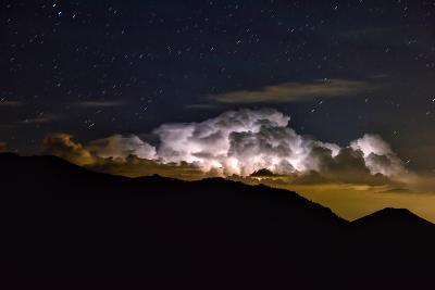 Storm Cloud Looms over the Mummy Range on a Starry Night in Rocky Mountain National Park-Keith Ladzinski-Photographic Print
