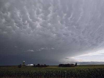 Storm Clouds over a Farm-Annie Griffiths Belt-Photographic Print