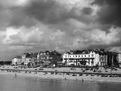 Storm Clouds Over the Promenade and the Beach from the Pier at Southsea Hampshire England--Photographic Print