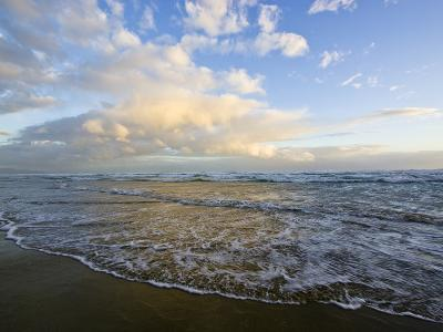 Storm Clouds Reflect Pastel Colors in Waves Rolling into Shore-Jason Edwards-Photographic Print