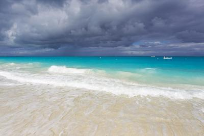 Storm Clouds Roll in over Turquoise Waters and a Beach-Mike Theiss-Photographic Print