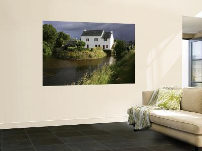Stormy Sky Behind Lock Keeper's Cottage on Canal De Languitre at Rose-Barbara Van Zanten-Wall Mural