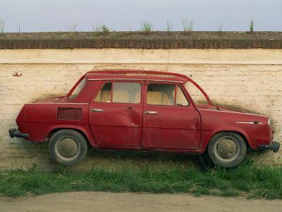Half a Skoda on a Wall in a Car Salesyard Near Piestany, Slovakia, Europe