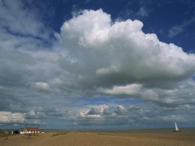 White Clouds in a Blue Sky at Shingle Street Near Felixstowe, Suffolk, England, United Kingdom