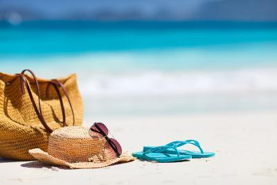 Straw Hat, Bag, Sun Glasses and Flip Flops on a Tropical Beach-BlueOrange Studio-Photographic Print