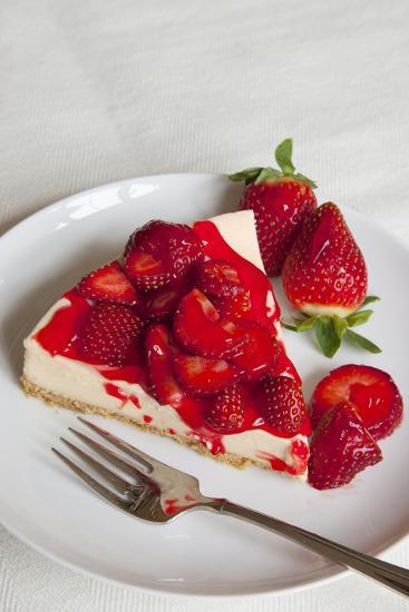 Strawberry Topped Cheesecake on a Round Plate-Brian Jannsen-Photographic Print