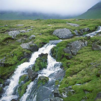 Stream Rushing over Rocks in a Wet Misty Environment, Estoroy Island, Faroe Islands, Denmark-David Lomax-Photographic Print