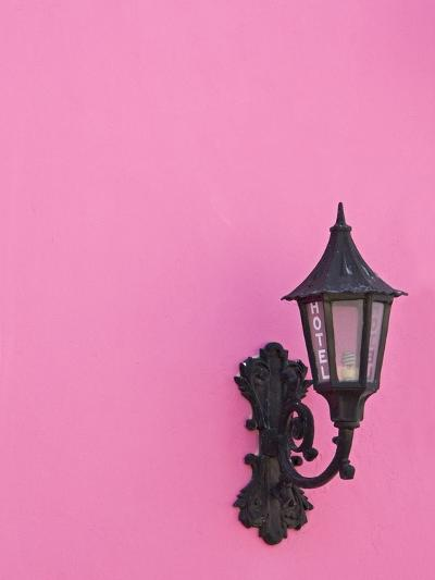 Street lamp on pink wall of Colonial style building-Keren Su-Photographic Print
