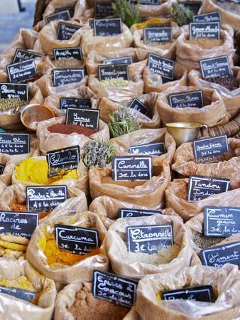 https://imgc.artprintimages.com/img/print/street-market-merchant-s-stall-provencal-spices-sanary-var-cote-d-azur-france_u-l-p24phq0.jpg?p=0