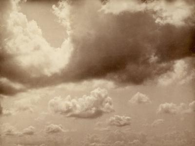 Stretch of Sky with Large Clouds. the Silhouette of the Hills Can be Made out Below--Photographic Print