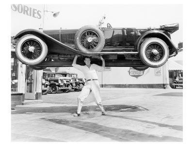 Strong Man Lifting A Car Over His Head--Art Print