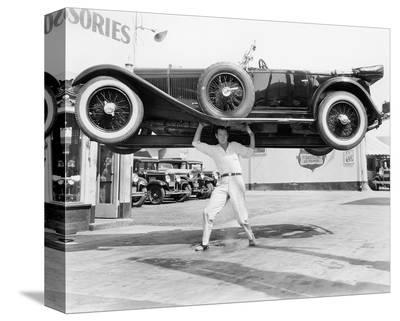 Strong Man Lifting A Car Over His Head--Stretched Canvas Print