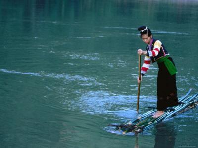 Ethnic Cong Woman Poles Bamboo Raft, Muong Tei, Lai Chau, Vietnam