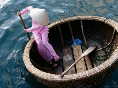 Woman Rows Basket Boat on Vietnam's South Central Coast, Nha Trang, Khanh Hoa, Vietnam