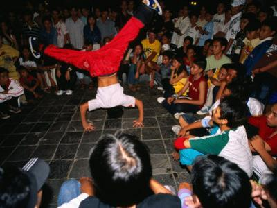 Youth Breakdancing with Crowd in Park on Dong Khoi Street, Ho Chi Minh City,  Vietnam