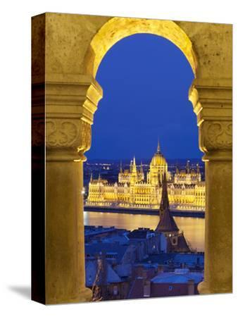 Parliament (Orszaghaz) Through Arches of Fishermen's Bastion (Halaszbastya) at Dusk, UNESCO World H