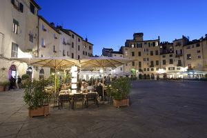 Restaurants in the Evening in the Piazza Anfiteatro Romano, Lucca, Tuscany, Italy, Europe by Stuart Black