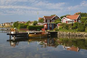 Swedish Red Summer Houses in Brandaholm, Dragso Island, Karlskrona, Blekinge, South Sweden, Sweden by Stuart Black