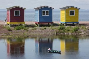 Colourfully Painted Huts by Shore of Atlantic Ocean at Heart's Delight-Islington in Newfoundland by Stuart Forster