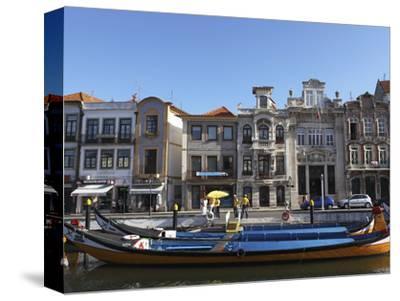 Moliceiro Boats Docked by Art Nouveau Style Buildings Along the Central Canal, Aveiro, Beira Litora