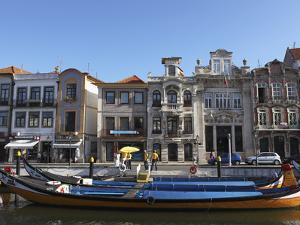 Moliceiro Boats Docked by Art Nouveau Style Buildings Along the Central Canal, Aveiro, Beira Litora by Stuart Forster