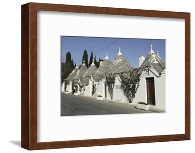 Row of 18th Century Trulli Houses in the Rione Monte District, Alberobello, Apulia, Italy
