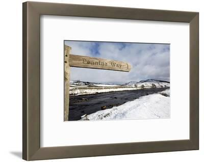 Sign for the Pennine Way Walking Trail on Snowy Landscape by the River Tees, County Durham, England