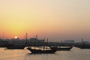 Traditional Wooden Dhow Boats in the Corniche Marina, at Sunset in Doha, Qatar, Middle East by Stuart