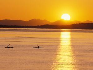 Kayaking at Sunset, San Juan Islands, Washington, USA by Stuart Westmoreland