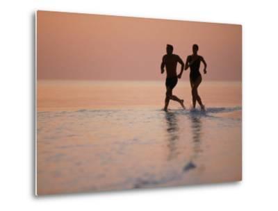 Couple Running on Beach, Felidu Atoll, Maldives