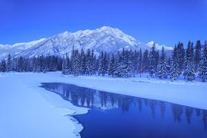 Sawback Range reflecting in Bow River near town of Banff, Canadian Rockies, Alberta, Canada by Stuart Westmorland