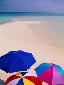 Umbrellas on Beach, Maldives by Stuart Westmorland