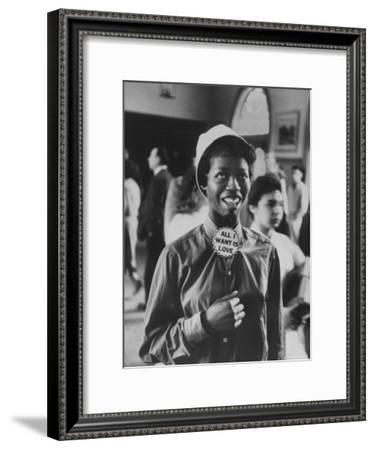 "Student Wearing Hat and Button on Shirt That Says: All I Want is Love on ""Old Clothes Day""-Gordon Parks-Framed Premium Photographic Print"