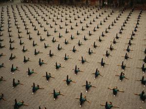 Students at Ta Gou Academy Lie on Their Backs and Kick into the Air
