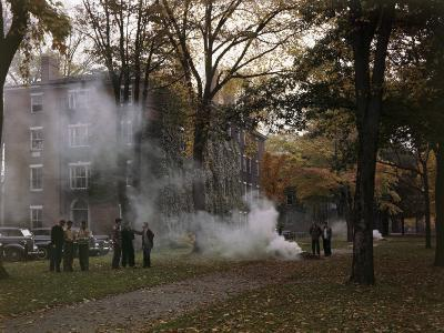 Students Gather by a Leaf Fire Outside a Dormitory at Bowdoin College-B^ Anthony Stewart-Photographic Print