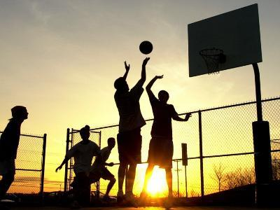 Students Play a Basketball Game as the Sun Sets at Bucks County Community College--Photographic Print