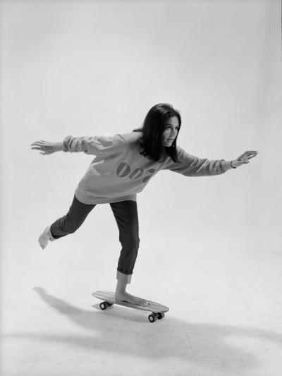 Studio Photos of Gloria Steinem Riding a Skateboard with a 007 James Bond Sweatshirt, 1965-Yale Joel-Photographic Print