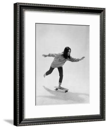 Studio Photos of Gloria Steinem Riding a Skateboard with a 007 James Bond Sweatshirt, 1965-Yale Joel-Framed Premium Photographic Print