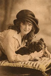 Studio Portrait, Young Woman with Pekingese Dog