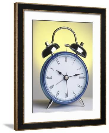 Studio Shot of a Blue and Silver Alarm Clock--Framed Photographic Print